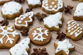 stock photo of christmas cookie  - Christmas Gingerbread Cookies homemade different forms on wooden table - JPG