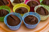 stock photo of chocolate muffin  - Chocolate Muffins in colorful paper cupcake holder - JPG