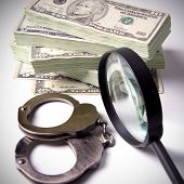 image of punishment  - Finance and Law economic crime the punishment of the offender pack of dollars steel handcuffs square image DSLR photography finance and law shadow capital punishment crime - JPG