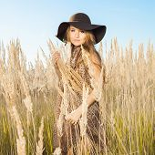 foto of tallgrass  - Ourdoors sunrise shot of a model in tallgrass meadow