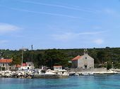 picture of graveyard  - The Krijal church with a graveyard situated at the local harbour on the small island Premuda in the Adriatic sea of Croatia - JPG