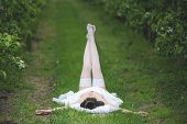 stock photo of orchard  - Woman in a white dress in the orchard - JPG