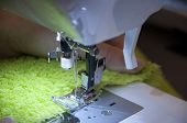 image of sewing  - Using a sewing machine to sew a towel cloth - JPG