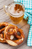 stock photo of pretzels  - Beer mug and pretzel on wooden table - JPG