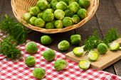 stock photo of brussels sprouts  - Brussels sprouts in basket and on rustic table - JPG