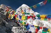 picture of buddhist  - view of Mount Pumo Ri with buddhist prayer flags from Kala Patthar way to Everest base camp Nepal - JPG