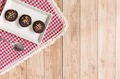 picture of cake-ball  - Fresh chocolate ball cakes sprinkled with colorful sugar balls - JPG