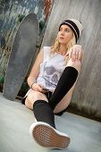 stock photo of nose ring  - Skateboard girl listening to music - JPG