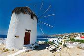 picture of greek-island  - White greek windmill overlooking traditional village on Mykonos Island - JPG