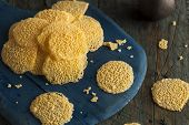 picture of crisps  - Homemade Parmesan Cheese Crisps on a Cutting Board - JPG