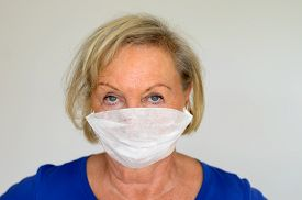 pic of matron  - Close up shot of female wearing a procedure mask - JPG