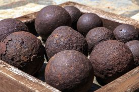 foto of cannon-ball  - Many of historical old cannon balls heap of iron rusty balls - JPG