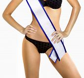 stock photo of beauty pageant  - part of woman shape of beautiful thigh in bikini with white tape of beauty contest with path - JPG