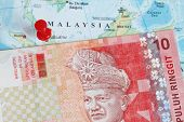 stock photo of ringgit  - Malaysian ringgit currency macro shot with malaysian background - JPG