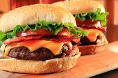 Juicy bacon cheeseburgers.