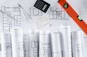 Top View Of Architect Blueprints, Ruler, Protractor, Calculator, Divider And Spirit Level poster