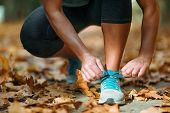 Woman Exercising Outdoors In The Fall poster