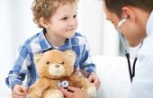 Doctor And Child Patient. Physician Examines Little Boy By Stethoscope. Medicine And Childrens Ther poster