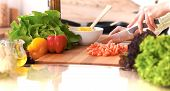 Close Up Of Human Hands Cooking Vegetable Salad In Kitchen On The Glass Table With Reflection. Healt poster