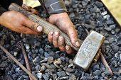 stock photo of blacksmith shop  - Detail of dirty hands holding hammer - blacksmith