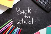 School Stationery Around Back To School Words On Slate Black Background. Back To School Concept. Top poster