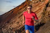Fit runner man sport athlete trail, running outside on volcano mountain in desert. Motivation and fo poster