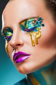 Fantasy Make-up. Closeup Of A Beautiful Woman With Fantasy Colorful Makeup With Yellow Tears poster
