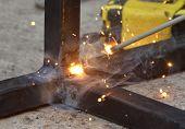 Spark From Weld Work When Welder Welding Iron, Steel Structure In Construction Site, Industrial Meta poster