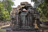 Ancient Ruins Of Krol Ko Temple In Angkor Wat Complex, Cambodia. Small Shrine With Stone Bas-relief. poster