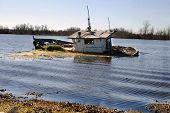 stock photo of katrina  - Hurricane Katrina sunk this vessel in Bayou Gauche near New Orleans Louisiana - JPG