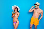 Glance Over The Glasses. Tanned Man Looks At The Dark Haired Cute Girl In A Colorful Bikini Whistlin poster