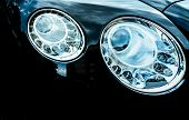 Closeup Detail Of Led Headlight Luxury Car. Beautiful Modern Elegance Headlamp Car. Black Automobile poster