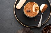 Delicious Italian Dessert Tiramisu, Chocolate, Cocoa And Coffee Beans On A Black Background. Top Vie poster