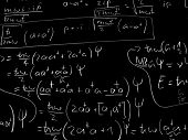 Quantum mechanics formulas on a blackboard