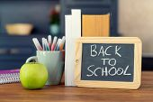 Back To School. Concept With Pens, Books, An Apple And Blackboard With Inscription : Back To School poster
