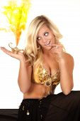 picture of genie  - a female genie looking at the smoke coming out of her genie lamp - JPG
