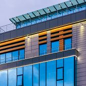 Modern High-rise Office Building With A Glass Facade At Overcast, Background. poster