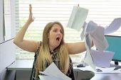Overworked Angry Businesswoman Throwing Paper All Over The Office. Stressed Woman Throwing Charts Or poster