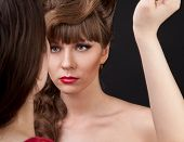 Hairdresser Doing Hairstyle To Beautiful Model