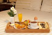 stock photo of trays  - breakfast tray on the bed of a hotel room - JPG