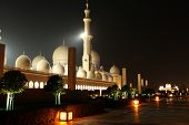 stock photo of emirates  - Sheikh Zayed Grand Mosque Abu Dhabi United Arab Emirates at night - JPG