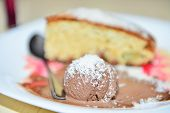 pic of souse  - Apple pie with chocolate ice cream and decoration souse in a white plate - JPG