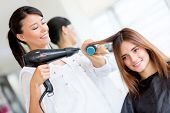 stock photo of blowers  - Woman with long hair at the beauty salon getting a blower - JPG