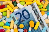 picture of placebo  - euro banknotes and pills - JPG