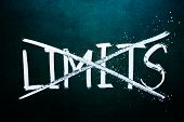 stock photo of restriction  - break the limits concept words on grunge board - JPG