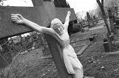 image of inri  - black and white jesus crucifix tombstone on a graveyard - JPG