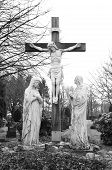 stock photo of inri  - black and white jesus crucifix statue on a graveyard - JPG
