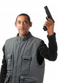 pic of extremist  - An aggressive looking man weilds a gun in his left  hand - JPG