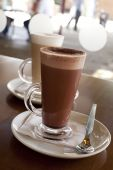 pic of hot-chocolate  - Hot chocolate in a tall class with Cafe Latte on a table - JPG