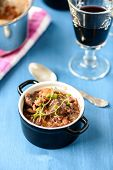picture of boeuf  - boeuf bourguignon classic french beef stew on blue table with a glass of red wine - JPG
